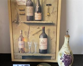 "Lot 1653.   $23. Wine Lovers Lot: Wine Print, LNT Olive Oil Cruet and 2 Wine Coasters. Print measures:  21.5"" H x 13.5 W"
