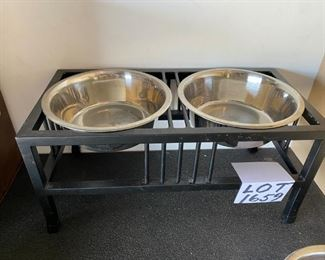 "Lot 1659.  $40.00  Baron Double Dog Diner  Stand and 3 Stainless Steel Bowls 10"" Diam x 4"" H (each bowl)."
