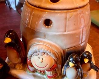 1671.  Asking $26.  Scented Wax melter with the penguins by Yankee Candle, 4 votives in a gold wire basket, and a darling  standing wooden snowman holding skis