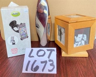 "Lot 1673.  $22   8"" Nambe Twisted Bud Vase, Spinning photo cube, and window and dashboard  iphone mount for an iphone 4"