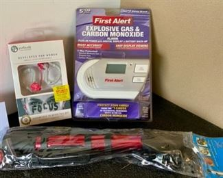 Lot 1712.  $20.00  First Alert CO2 Gas and CO2 Alarm, Bike Pump and Ear Buds