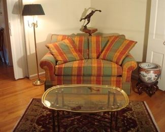 "Living Room:  This quality CENTURY brand 64"" love seat has two detached back cushions and one detached bench cushion as well as two matching toss pillows.  A classic brass ""bugle"" floor lamp with black shade is to the left, while a ceramic fish bowl on stand is on the right.  Closer photos of the other items follow."