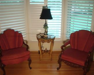 Living Room:  ONE of the chairs sold.  The small, ornate octagonal table and porcelain bird lamp and ONE chair are still available.