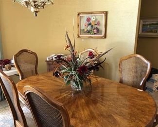 Lovely vintage dining room table, and fruit oil painting.