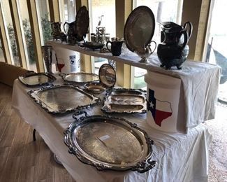Large silver serving pieces and nice pitchers