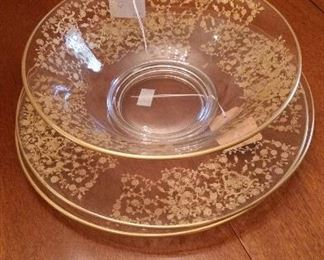 Etched glass center bowl, contains 24k gold decorative fill, with two matching underplates. Circa 1940s American
