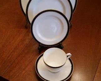 A partial dinner service by Spode, White porcelain, cobalt band rimmed in gold.