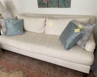 White sofa and pillows