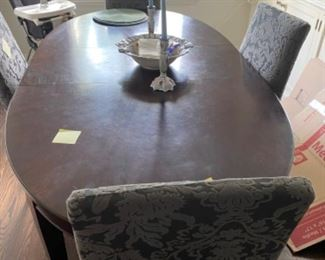 Dark brown, oval dining table with Crate and Barrel chairs