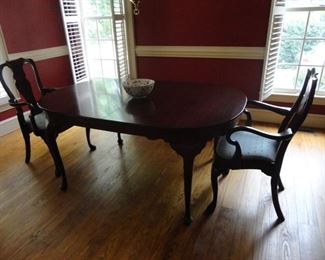 Table has padded cover and leaves. Only 2 chairs in this set. Hinkle Harris maker in Cherry wood