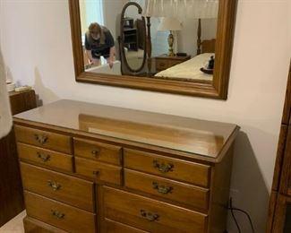 #11Flint Ridge Dresser w/9 drawers w/glass protect w/mirror  54x20x34  Mirror 43x33 $125.00