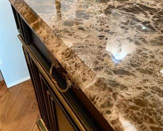 Close up of natural stone top on luxurious buffet by Henredon.