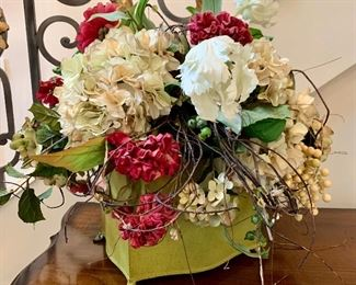 """$100 - Beautiful floral arrangement in green planter. The container measures 9"""" x 7"""" and the planter with floral arrangement measures a total of 19"""" tall."""