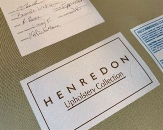 Close up of labels on Blue Tufted-Back Sectional Sofa by Henredon.