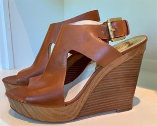 Price coming soon! Michael Kors Brown Leather Wedge Sandal. Womens size 10.