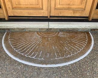 $20 - Crescent Shaped Outdoor Mat