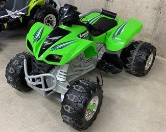 """$100-Kawasaki XFX by Power Wheels. Measures 42""""L x 29""""W x 27""""H."""