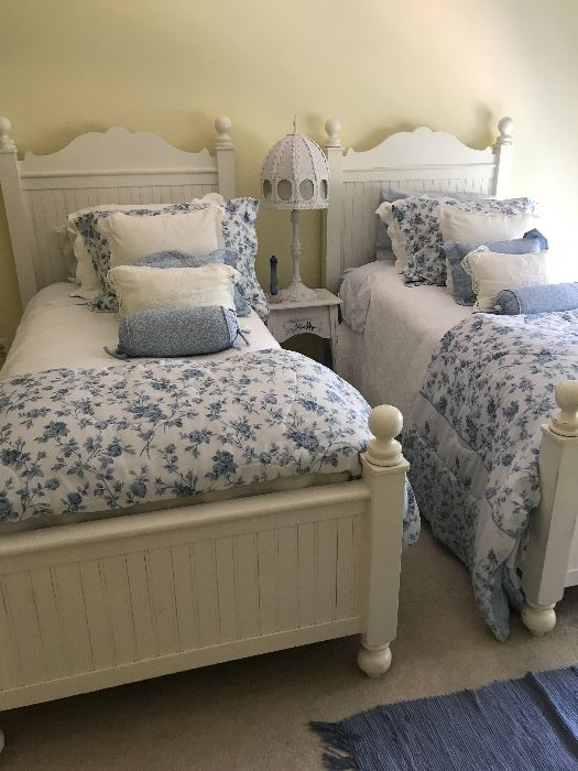 Twin beds , complete with bedding