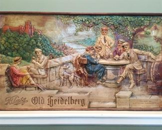 BLATZ BEER OLD HEIDELBERG ADVERTISING SIGN Painted reinforced plaster relief cast with outdoor genre scene of men and women seated and drinking. Marked lower right ''Copyright 1933, Blatz Brewing Co. Milwaukee Wis.'' Overall framed 25'' x 42 1/2'