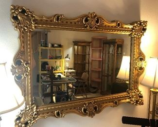 several gold framed  retro /vintage mirrors  this is a large one  located downstairs
