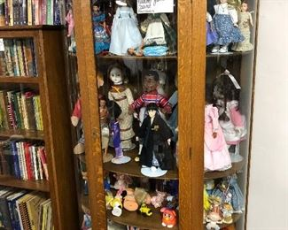 Antique Oak Cabinet and Various Dolls