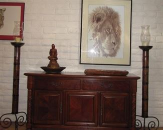 Bamboo candle sconces, rustic bread tray, framed lion print