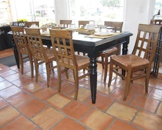 Black country farmhouse table .                                              Eight Italian rush bottom seat chairs sold separately