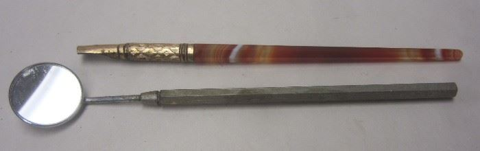 Antique writing pen and dental mirror