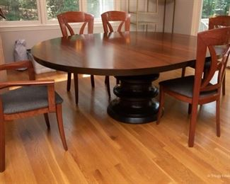 """Exotic Woods Pedestal Dining Table $550 80.25 x 60 x 30.75 (shown with leaf in), without leaf, the table is 60"""" round"""