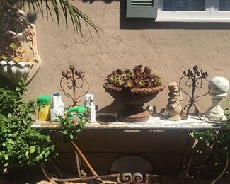 Large and gorgeous outdoor table, more outdoor wall and ground decor & artistic potted succulents.