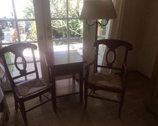 Red wood chairs and table and lamp. All furniture is In amazing shape.