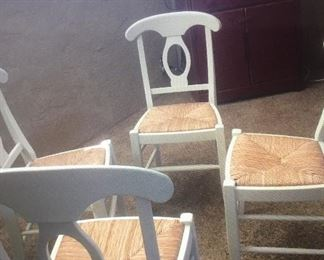 Set of 4 white and wicker chairs. Excellent condition. Great price.