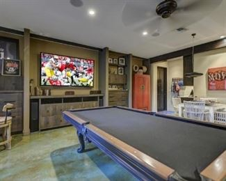 Custom made pool table has a drawer for cue & rack storage