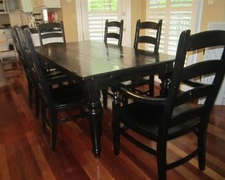 POTTERY BARN BLACK TABLE WITH 2 END LEAVES AND 8 CHAIRS AND 2 ARM CHAIRS