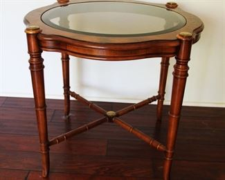 "#24.  $50.00. Glass top side table 23.5""h  X 29"" diameter"