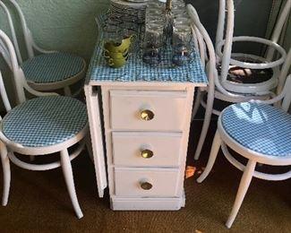 Drop leaf table and chairs. Vintage  Melmac plate set.  Vintage glassware