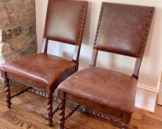 pair of leather side chairs with turned legs by Stanley