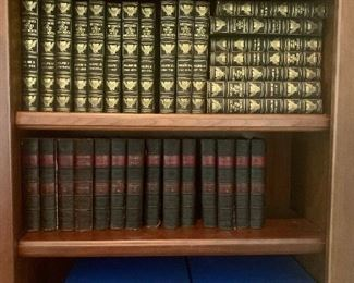 """several sets of antique or vintage books Top shelves: """"Messages & Papers of the Presidents"""", Bottom shelf: """"Photographic History of the Civil War"""""""