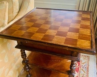 the checkerboard side of the flip-top game table