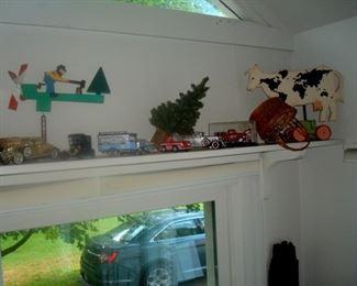 Shelf of antique & vintage toys.