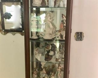 Display cabinet with Lladro & Armani collection