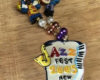 https://www.ebay.com/itm/124277149992WL7076: Jazzfest 2005 Michael Hunt New Orleans Jazz Festival Plaque NecklaceAuction