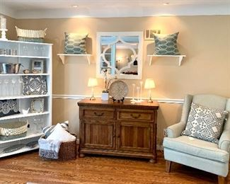 Amazing decor that people want!  The cute plate in the middle of  the picture, the gray and white pillow pair on the shelves, the gray and white pillow on the white shelves, the picture frame to the right of the bird on the white shelves and the pillow in the chair are all SOLD!