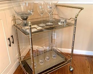 """$150 - TRENDY Brass Bar Cart. Note: There is a very small chip on the corner - barely noticeable! Measures 25.5"""" x 17"""" x 33.5"""".  The tray on the lower shelf is SOLD!"""