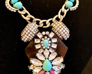Close up of one of several statement necklaces.