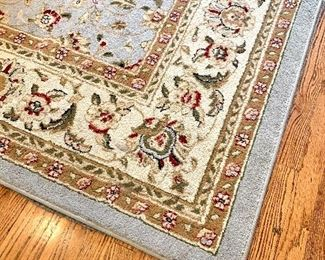 $200 - Light Blue and Ivory Rug with Rug Pad - Measures approx. 8' x 10'.