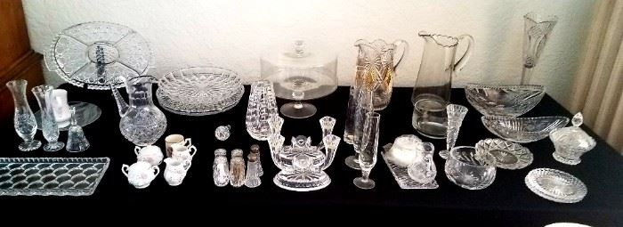 Crystal serving pieces candle holders, vases, platters, cake plate, pitcher, salt and pepper