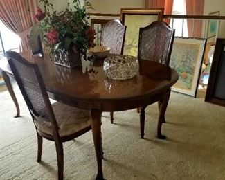 Dining set, 4 armless chairs, two armed chairs.  In excellent condition.  Was always covered with a table pad.  Matches China cabinet.