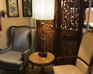 Beautiful carved wood room divider. Wonderful clean non-smoking, no pet home Blue high back chair and beige dining table