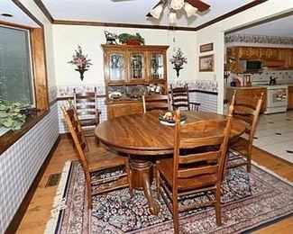 HEAVY SOLID WOOD DINING TABLE AND CHINA CABINET ON A KASHIMAR AREA RUG  5.5 X 8.3                 (LIKE NEW)